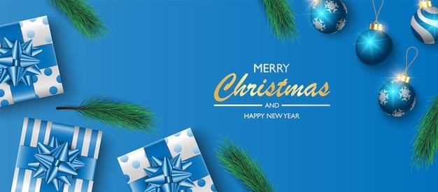 Boîte de cadeaux de conception de fond de bannière de noël sur le fond bleu fond de couverture de noël