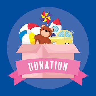 Boîte de dons de charité avec des jouets