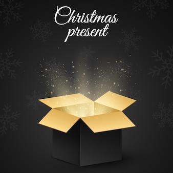 Boîte dorée de noël avec un cadeau secret pour les vacances.