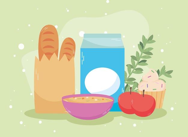 Boîte de lait et pommes