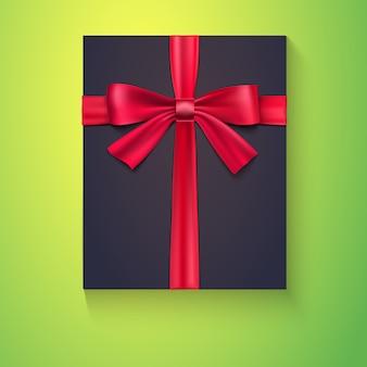 Boîte noire avec ruban rouge et noeud vert