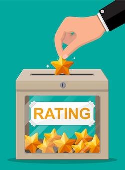 Boîte de notation et main avec étoile dorée. avis cinq étoiles. témoignages, notes, commentaires, sondage, qualité et avis. illustration dans un style plat