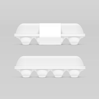 Boîte à œufs blanc isolé sur fond