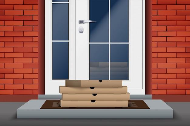 Boîte à pizza de livraison sans contact sur le pas de la porte