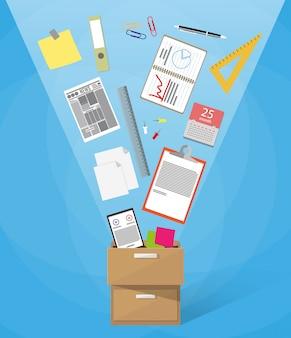 Boîte pleine de fournitures de bureau