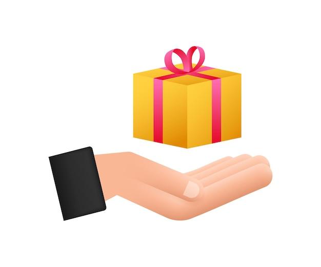 Boîte de prix en or dans un style incroyable dans les mains. présenter l'icône de boîte-cadeau. illustration vectorielle de stock.