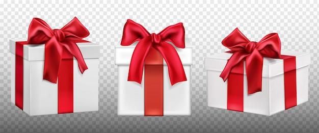 Boîtes cadeaux ou cadeaux avec un arc rouge.