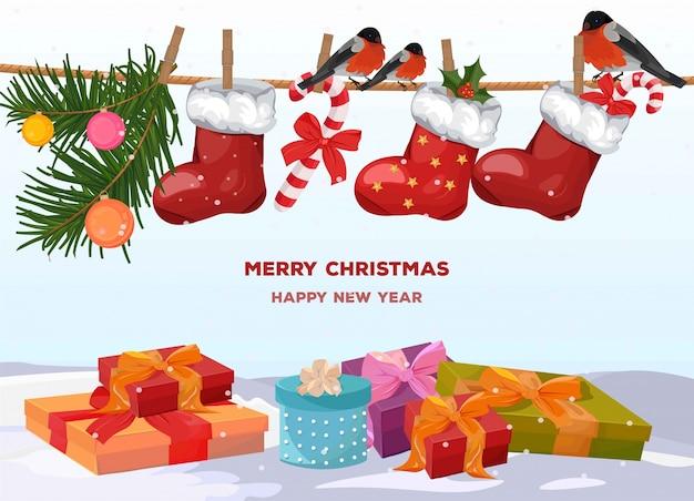 Boîtes à cadeaux colorés joyeux noël et chaussettes santa rouges
