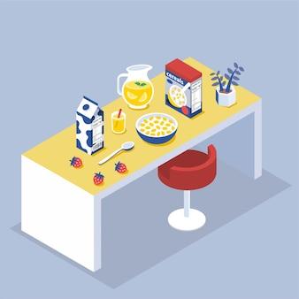 Bol et boîte de flocons de maïs avec pichet de jus sur table à manger