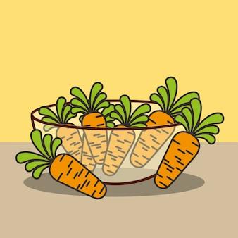 Bol en verre avec carottes fraîches