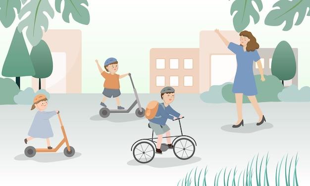 Bon retour au semestre. les élèves à la maison près de l'école se rendent à l'école à vélo.