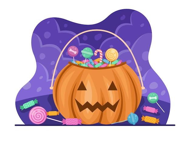 Bonbons d'halloween dans un sac ou un panier de citrouille pour célébrer le jour d'halloween