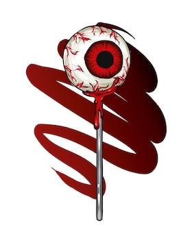 Bonbons sous la forme d'un œil sur un bâton la peur d'halloween et les vacances d'automne