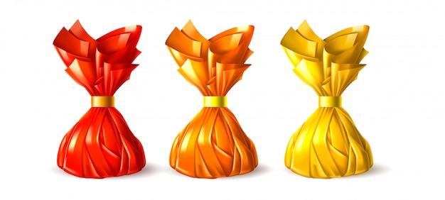 Bonbons de truffes au chocolat réalistes dans un emballage rouge, jaune