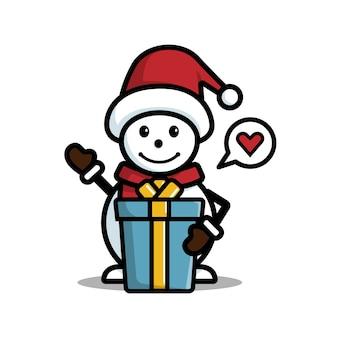 Bonhomme de neige heureux avec chapeau et cadeau isolé sur fond blanc