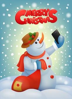 Bonhomme de neige de noël avec téléphone intelligent faisant selfie