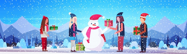 Bonhomme de neige et personnes avec bannière de cadeaux