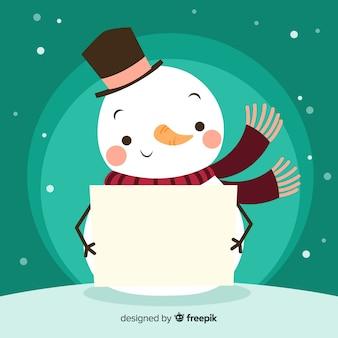Bonhomme de neige tenant une pancarte blanche