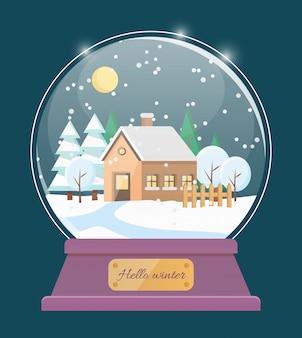 Bonjour globe de neige d'hiver avec maison dans un village