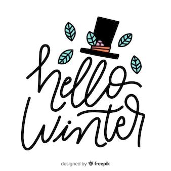Bonjour lettrage d'hiver et chapeau haut de forme avec des feuilles