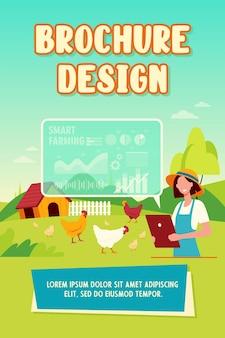 Bonne agricultrice travaillant avec un modèle de brochure de ferme intelligente