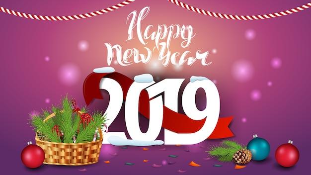 Bonne année 2019 - carte de voeux rose avec un panier avec une branche d'arbre de noël