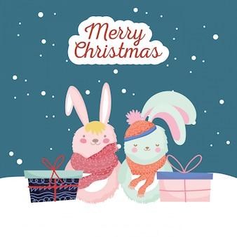 Bonne année 2020 célébration lapins mignons avec de la neige cadeaux écharpe