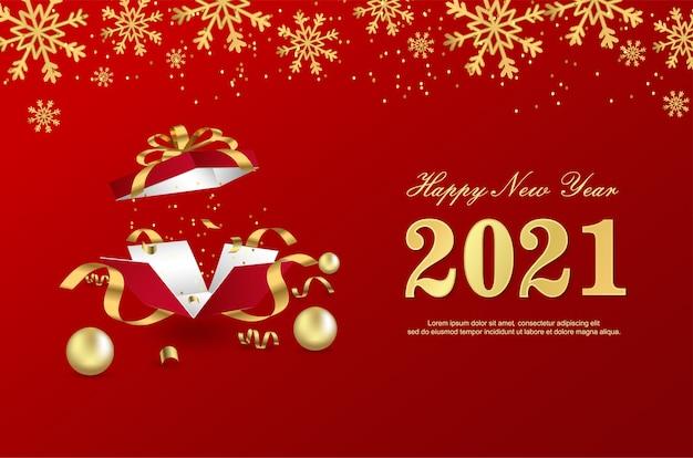 Bonne année 2021 avec boîte-cadeau ouverte sur fond rouge.
