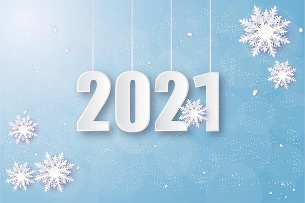Bonne année 2021 avec des chiffres blancs aux nuances hivernales.