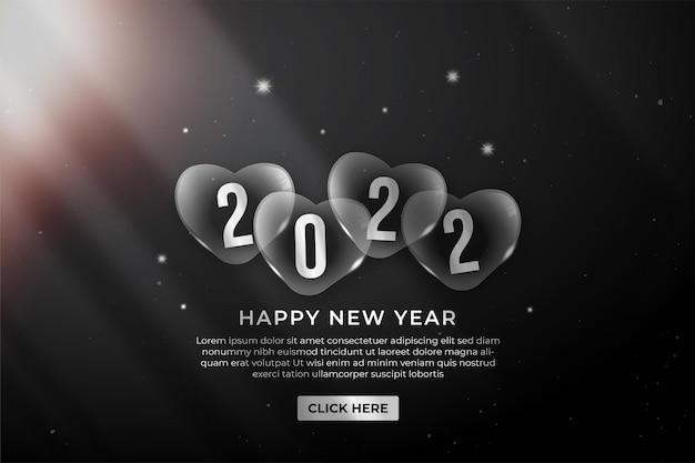 Bonne année 2022 bannière web élégant ballon sur fond noir
