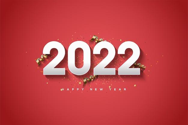 Bonne année 2022 avec des chiffres en argent et des morceaux de ruban d'or