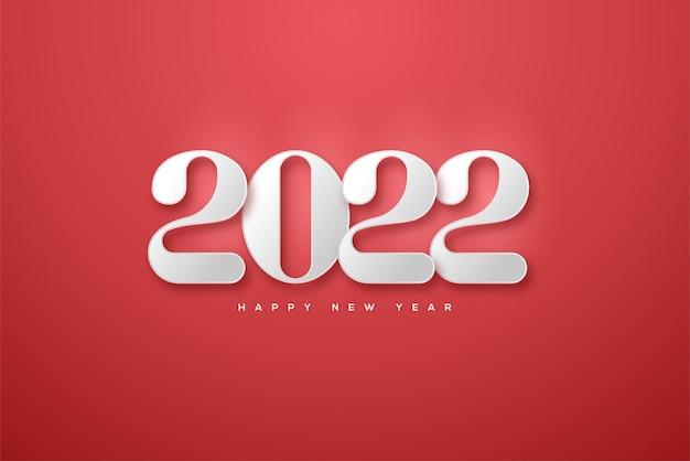 Bonne année 2022 avec des chiffres blancs sur fond rouge vif