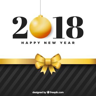 Bonne année avec l'arc de cadeau d'or