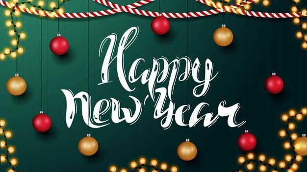 Bonne année, carte de voeux horizontale verte avec belle lettrage et décor de noël.
