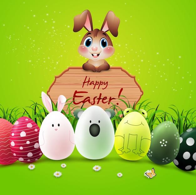 Bonne carte de voeux de pâques avec des lapins, des oeufs colorés et un panneau en bois