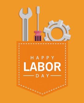 Bonne fête du travail avec des outils et des engrenages dans la poche