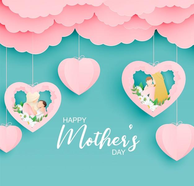 Bonne fête des mères avec la mère embrasse son bébé dans un style de papier découpé.
