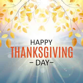 Bonne fête de thanksgiving avec des feuilles naturelles d'automne brillant.