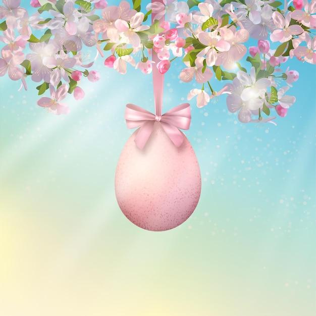 Bonne illustration de pâques. branche d'arbre en fleurs au printemps avec des oeufs de pâques suspendus