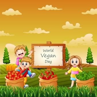 Bonne journée mondiale végétalienne avec des enfants dans le jardin
