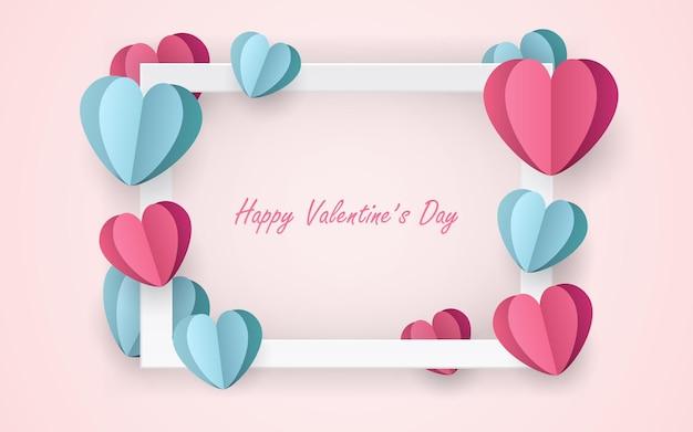 Bonne saint valentin dans un cadre photo blanc avec du papier découpé en forme de coeur
