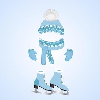 Un bonnet avec un pompon duveteux, une écharpe, des mitaines. patins avec fourrure. journée des sports d'hiver.