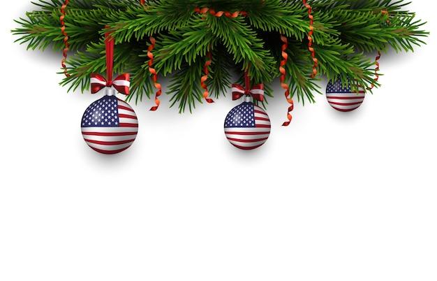 Bordure de branches d'arbres de noël avec ruban rouge et boules avec drapeau américain. joyeux noël et bonne année carte