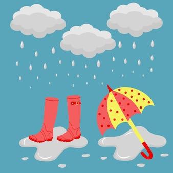 Des bottes en caoutchouc et un parapluie sous la pluie dans une flaque d'eau. bannière de modèle de temps pluvieux.