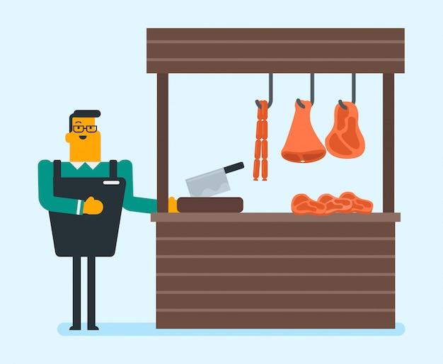 Boucher offrant de la viande fraîche dans la boucherie.