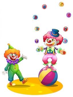 Bouffon jonglant balles sur la balle