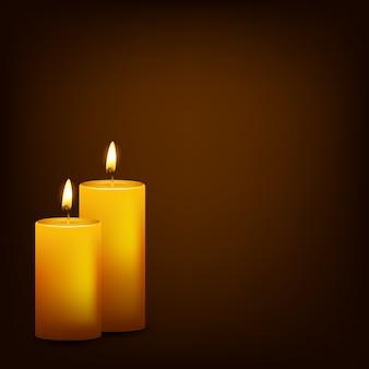 Bougies allumées sur un fond sombre