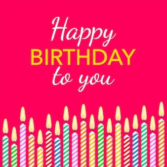 Bougies colorées avec des bougies différentes et texte joyeux anniversaire.