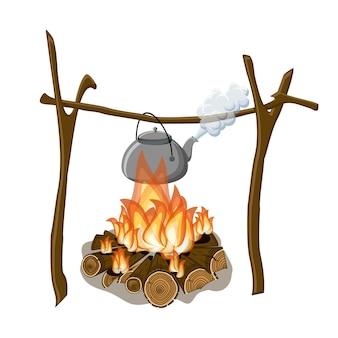 Une bouilloire bouillante suspendue au-dessus d'un feu de camp.