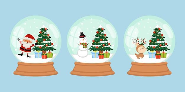 Boule à neige avec un joli ensemble de décorations de noël